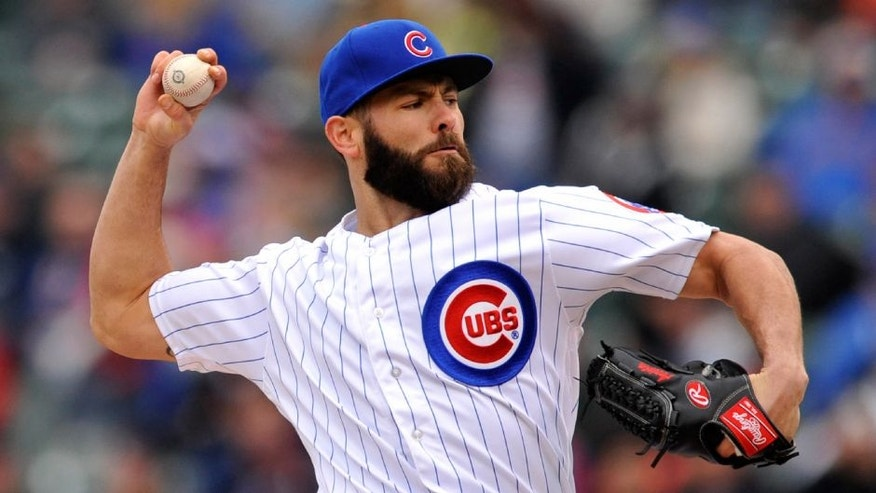 Chicago Cubs starter Jake Arrieta delivers a pitch during the first inning of a baseball game against the Milwaukee Brewers. The Cubs won 7-2.