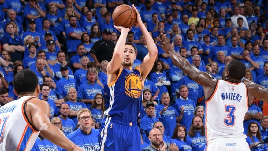 OKLAHOMA CITY, OK - MAY 28: Klay Thompson #11 of the Golden State Warriors shoots against Dion Waiters #3 of the Oklahoma City Thunder in Game Six of the Western Conference Finals during the 2016 NBA Playoffs on May 28, 2016 at Chesapeake Energy Arena in Oklahoma City, Oklahoma. NOTE TO USER: User expressly acknowledges and agrees that, by downloading and or using this photograph, User is consenting to the terms and conditions of the Getty Images License Agreement. Mandatory Copyright Notice: Copyright 2016 NBAE (Photo by Andrew D. Bernstein/NBAE via Getty Images)