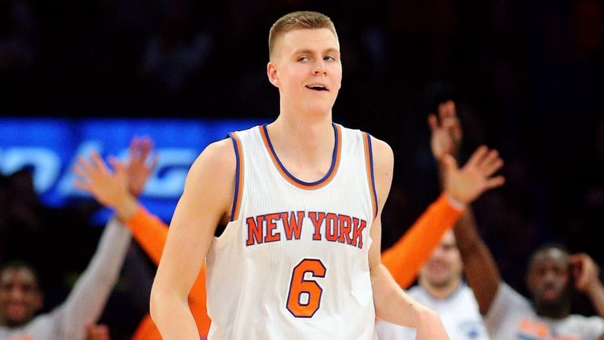 Jan 10, 2016; New York, NY, USA; New York Knicks power forward Kristaps Porzingis (6) reacts after hitting an off balance three point shot as the shot clock expired against the Milwaukee Bucks during the fourth quarter at Madison Square Garden. The Knicks defeated the Bucks 100-88. Mandatory Credit: Brad Penner-USA TODAY Sports
