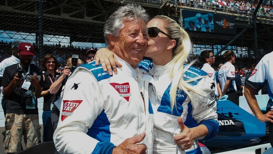 INDIANAPOLIS, IN - MAY 29: Mario Andretti receives a kiss from Lady Gaga before the start of the Indy 500 at the Indianapolis Motor Speedway on May 29, 2016 in Indianapolis, Indiana. (Photo by Michael Hickey/Getty Images)