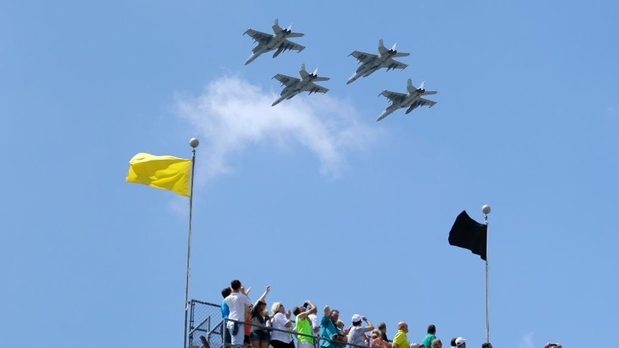 Four F-18E fighters perform a flyover before the start of the 100th running of the Indianapolis 500 auto race at Indianapolis Motor Speedway in Indianapolis, Sunday, May 29, 2016. (AP Photo/Jeff Roberson)