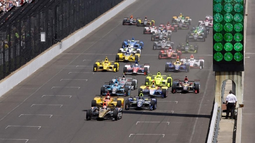 James Hinchcliffe, of Canada, leads the field into the first turn on the start of the 100th running of the Indianapolis 500 auto race at Indianapolis Motor Speedway in Indianapolis, Sunday, May 29, 2016. (AP Photo/R Brent Smith)