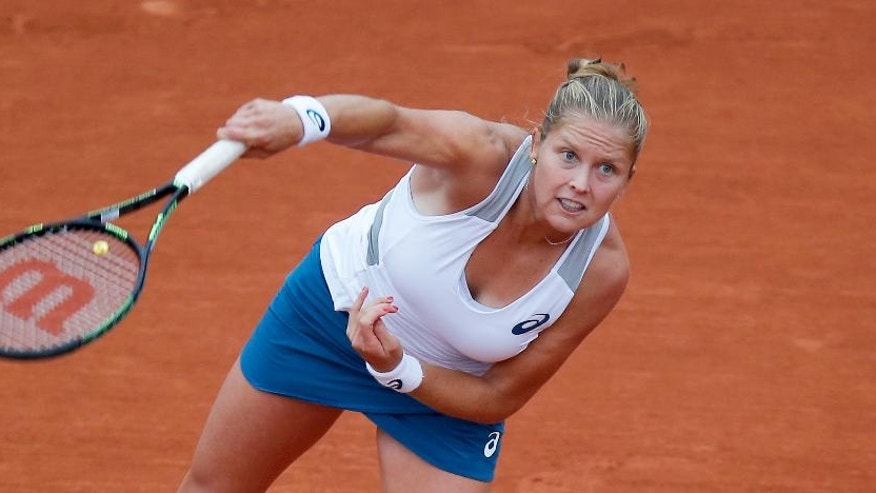 Shelby Rogers of the U.S. serves in the fourth round match of the French Open tennis tournament against Romania's Irina-Camelia Begu at the Roland Garros stadium in Paris, France, Sunday, May 29, 2016. (AP Photo/Michel Euler)