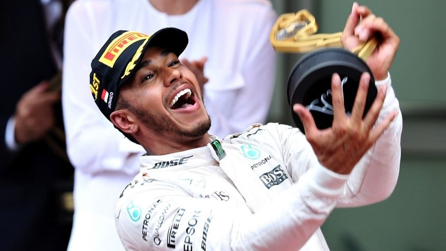 MONTE-CARLO, MONACO - MAY 29: Lewis Hamilton of Great Britain and Mercedes GP celebrates his win on the podium during the Monaco Formula One Grand Prix at Circuit de Monaco on May 29, 2016 in Monte-Carlo, Monaco. (Photo by Mark Thompson/Getty Images)
