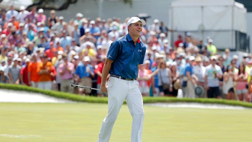Jordan Spieth reacts to missing a putt for birdie on the ninth green during the final round of the Dean & DeLuca Invitational golf tournament at Colonial, Sunday, May 29, 2016, in Fort Worth, Texas. (AP Photo/Tony Gutierrez)