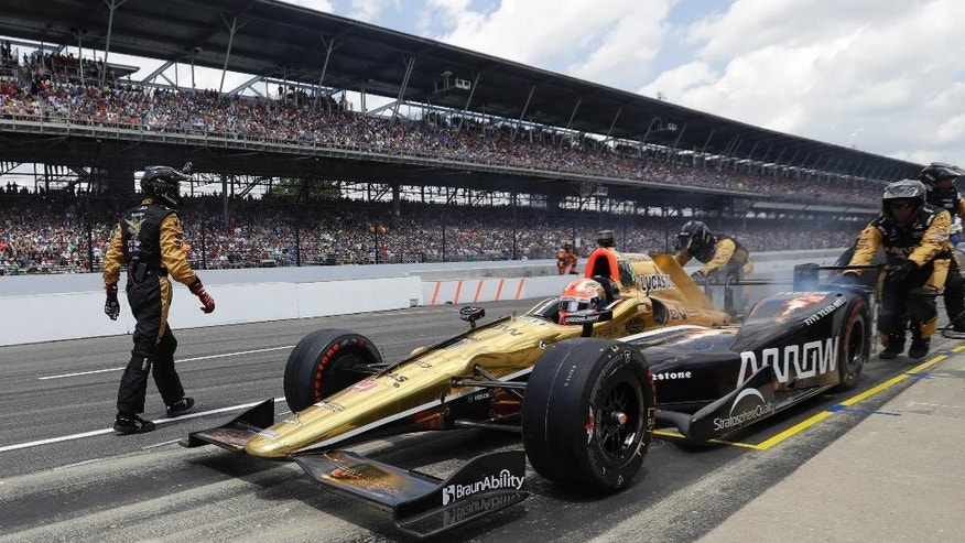 James Hinchcliffe, of Canada, pulls out of the pit area after a pit stop during the 100th running of the Indianapolis 500 auto race at Indianapolis Motor Speedway in Indianapolis, Sunday, May 29, 2016. (AP Photo/Darron Cummings)