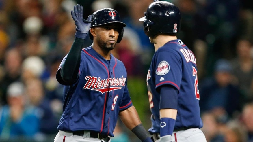 Minnesota Twins third baseman Eduardo Nunez celebrates with second baseman Brian Dozier after Nunez hit a solo home run during the fifth inning against the Seattle Mariners.