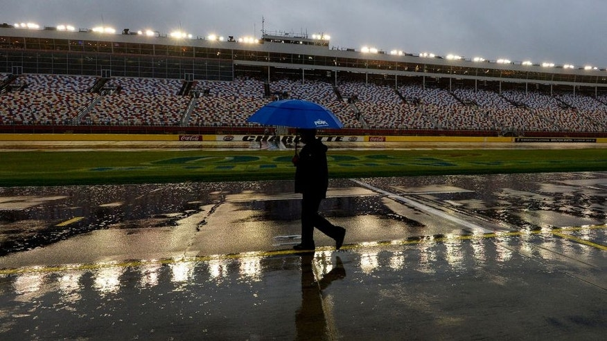 CHARLOTTE, NC - OCTOBER 10: A man walks down a flooded pit road during a rain delay for the NASCAR Sprint Cup Series Bank of America 500 at Charlotte Motor Speedway on October 10, 2015 in Charlotte, North Carolina. (Photo by Robert Laberge/Getty Images)