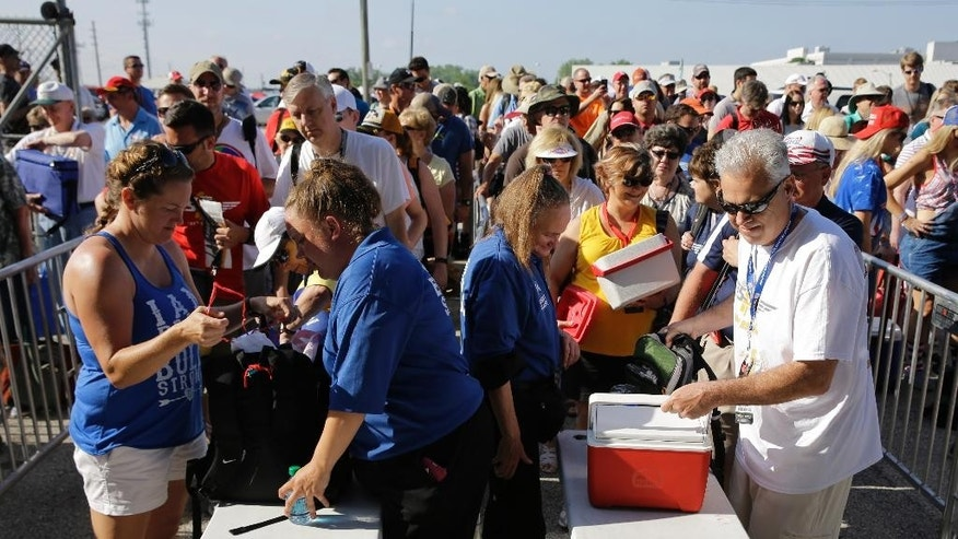 Fans make their way through security as they arrive before the 100th running of the Indianapolis 500 auto race at Indianapolis Motor Speedway in Indianapolis, Sunday, May 29, 2016. (AP Photo/Jeff Roberson)