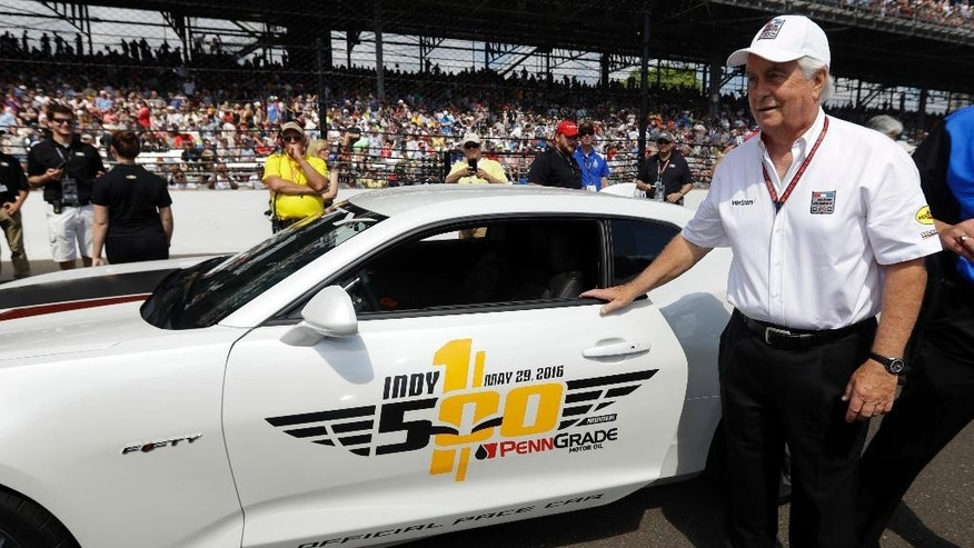 Pace car driver and car owner Roger Penske walks to the pace car before the 100th running of the Indianapolis 500 auto race at Indianapolis Motor Speedway in Indianapolis, Sunday, May 29, 2016. (AP Photo/Darron Cummings)