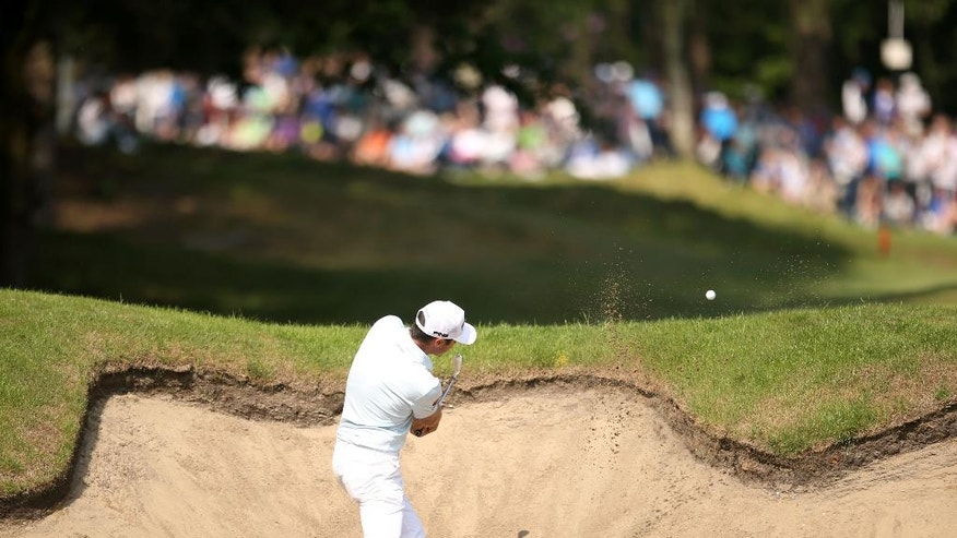 France's Julien Quesne plays a bunker shot on the 13th hole, during day four of the PGA golf Championship at Wentworth Club, Windsor, England, Sunday, May 29, 2016. (Steve Paston/PA via AP)     UNITED KINGDOM OUT        -      NO SALES      -      NO ARCHIVES
