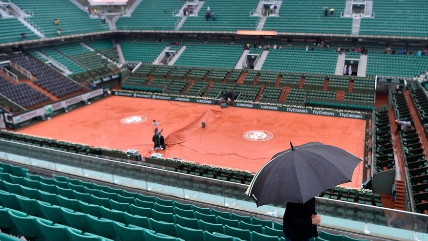 PARIS, FRANCE - MAY 30: Prolonged heavy rain prevents play from starting on day nine of the 2016 at Roland Garros on May 30, 2016 in Paris, France. (Photo by Dennis Grombkowski/Getty Images)
