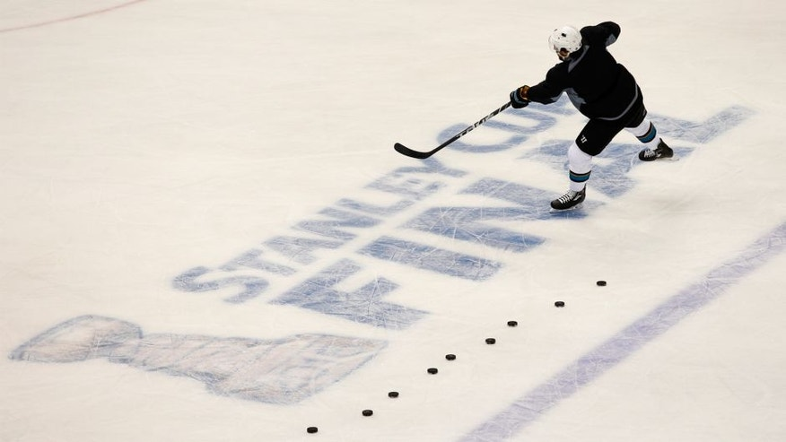 <p>Brenden Dillon #4 of the San Jose Sharks takes shots during the NHL Stanley Cup Final Media Day at Consol Energy Center on May 29, 2016 in Pittsburgh, Pennsylvania. (Photo by Justin K. Aller/Getty Images)</p>