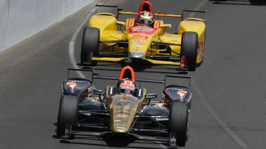 James Hinchcliffe, of Canada, leads Ryan Hunter-Reay into the first turn during the 100th running of the Indianapolis 500 auto race at Indianapolis Motor Speedway in Indianapolis, Sunday, May 29, 2016. (AP Photo/R Brent Smith)