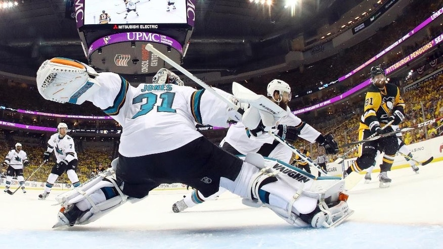 San Jose Sharks goalie Martin Jones (31) defends against Pittsburgh Penguins' Phil Kessel (81) during the second period in Game 1 of the Stanley Cup final series Monday, May 30, 2016, in Pittsburgh. (AP Photo/Bruce Bennett)