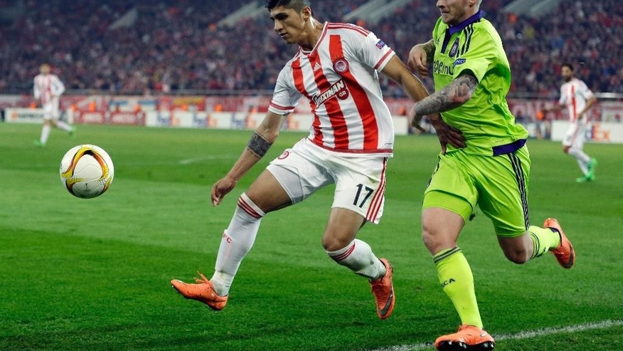 Feb. 25, 2016: Olympiakos' Alan Pulido, left, fights for the ball with Anderlecht's Alexander Buttner during the Europa League round of 32 soccer match at the Georgios Karaiskakis stadium in the port of Piraeus, Greece.