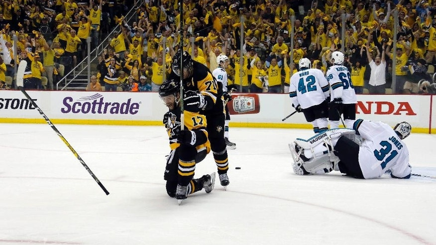 Pittsburgh Penguins' Bryan Rust (17) celebrates with Evgeni Malkin (71) his goal against San Jose Sharks goalie Martin Jones (31) during the first period in Game 1 of the Stanley Cup final series Monday, May 30, 2016, in Pittsburgh. (AP Photo/Keith Srakocic)