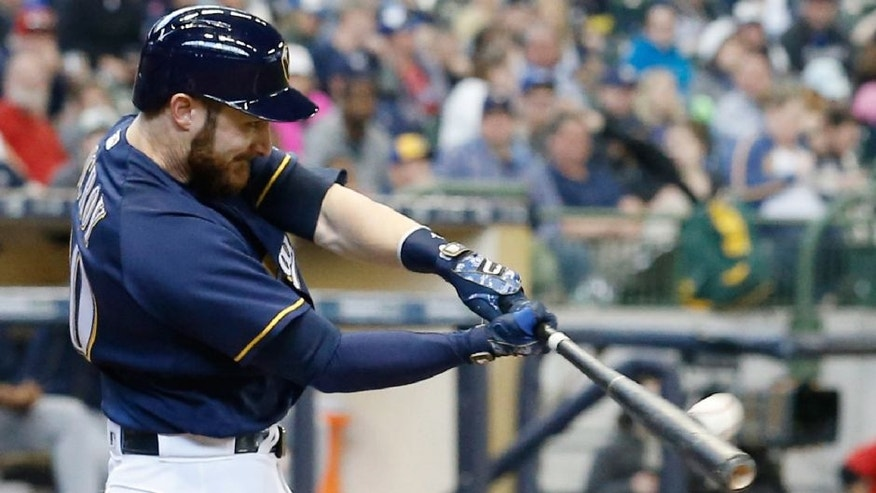 Milwaukee Brewers' Jonathan Lucroy hits a home run during the fifth inning of a baseball game against the San Diego Padres.