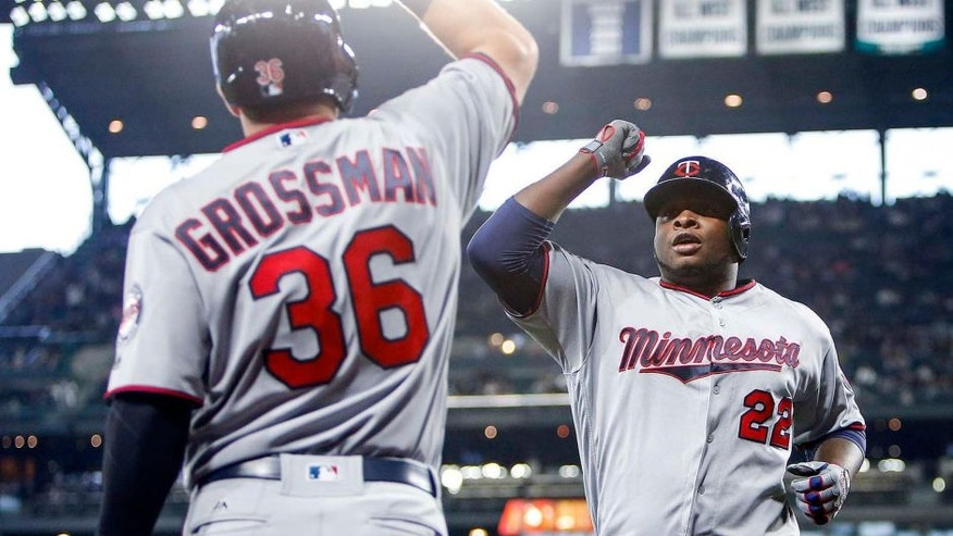 Friday, May 27: Minnesota Twins right fielder Miguel Sano celebrates with left fielder Robbie Grossman after Sano hit a solo home run against the Seattle Mariners.