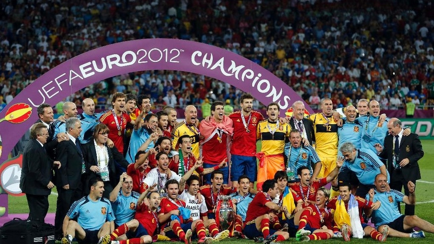 FILE - In this Sunday, July 1, 2012 file photo, the Spanish team poses with the trophy after  the Euro 2012 soccer championship final  between Spain and Italy in Kiev, Ukraine. The European Championship has a reputation for being the soccer fans' favorite tournament on the global calendar. (AP Photo/Matthias Schrader, File)