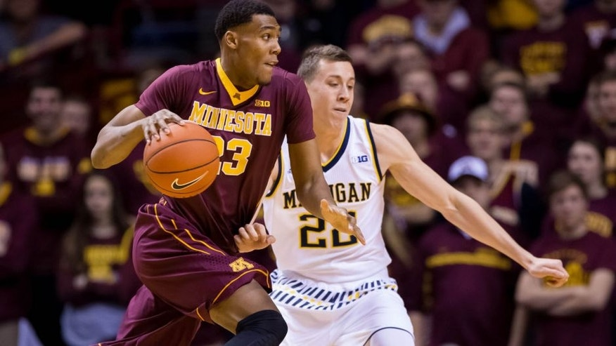 <p>Minnesota Gophers forward Charles Buggs dribbles against Michigan Wolverines guard Duncan Robinson Wednesday in Minneapolis.<br> </p>