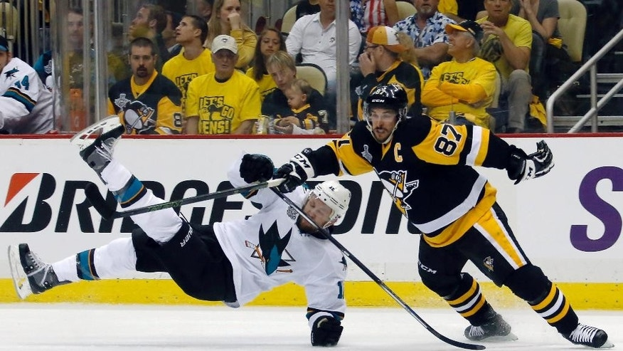 Pittsburgh Penguins' Sidney Crosby (87) checks San Jose Sharks' Nick Spaling (16) to the ice during the first period in Game 1 of the Stanley Cup final series Monday, May 30, 2016, in Pittsburgh. (AP Photo/Keith Srakocic)