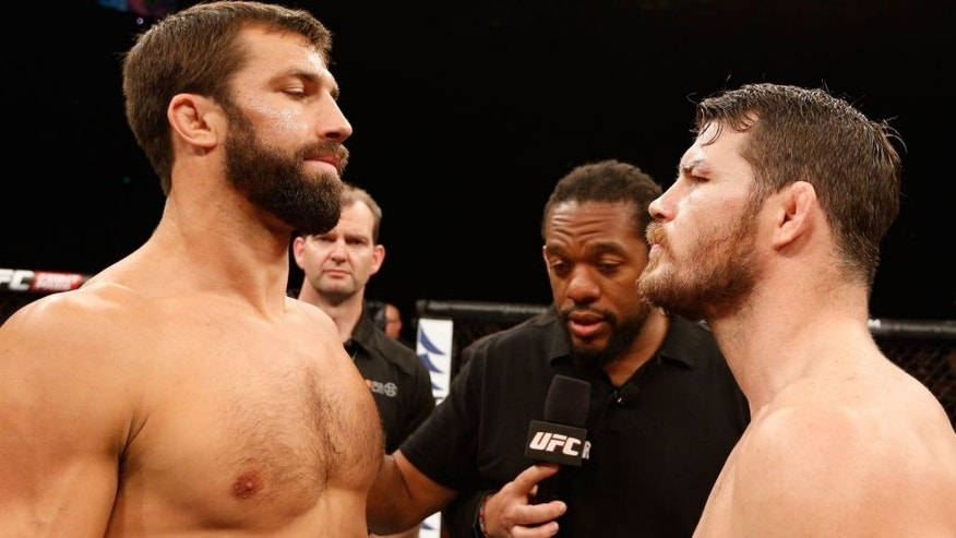 SYDNEY, NSW - NOVEMBER 08: (L-R) Opponents Luke Rockhold of the United States and Michael Bisping of England face off before their middleweight bout during the UFC Fight Night event inside Allphones Arena on November 8, 2014 in Sydney, Australia. (Photo by Josh Hedges/Zuffa LLC/Zuffa LLC via Getty Images)