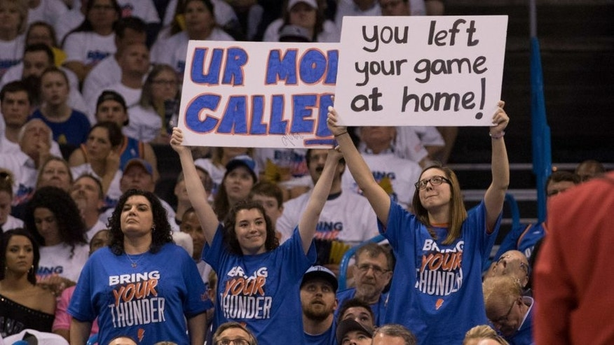 OKLAHOMA CITY, OK - APRIL 16: Oklahoma City Thunder fans taunt Dallas Mavericks players during the first half of Game One of the Western Conference Quarterfinals during the 2016 NBA Playoffs at the Chesapeake Energy Arena on April 16, 2016 in Oklahoma City, Oklahoma. NOTE TO USER: User expressly acknowledges and agrees that, by downloading and or using this photograph, User is consenting to the terms and conditions of the Getty Images License Agreement. (Photo by J Pat Carter/Getty Images) *** Local Caption *** ;
