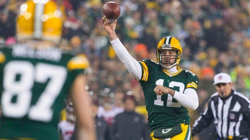 Monday, December 8: Green Bay Packers quarterback Aaron Rodgers (center) throws a pass to wide receiver Jordy Nelson (left) during the first quarter against the Atlanta Falcons at Lambeau Field.