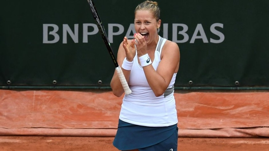 US player Shelby Rogers celebrates after beating Romania's Irina Begu at the end of their women's fourth round match at the Roland Garros 2016 French Tennis Open in Paris on May 29, 2016. / AFP / MIGUEL MEDINA (Photo credit should read MIGUEL MEDINA/AFP/Getty Images)