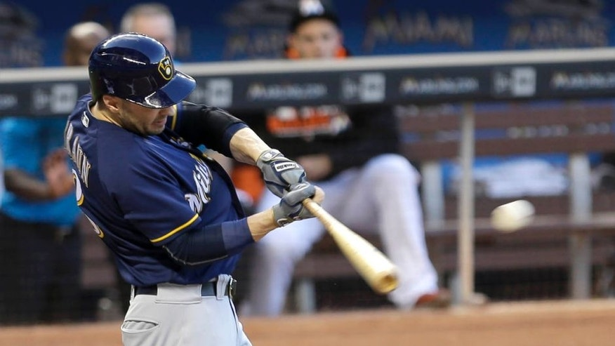 Tuesday, May 10, 2016: The Milwaukee Brewers' Ryan Braun follows through on a single against the Miami Marlins in the first inning in Miami. Jonathan Villar scored on the base hit. The Brewers won 10-2.