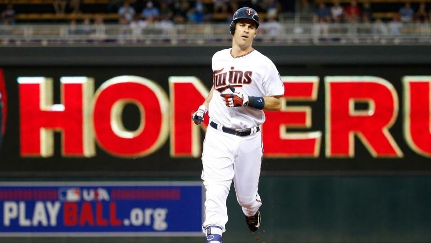 Minnesota Twins' Joe Mauer rounds the bases on his solo home run off Kansas City Royals starting pitcher Ian Kennedy.