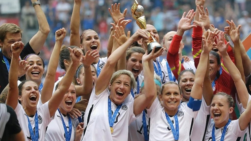 FILE - In this July 5, 2015, file photo, the United States Women's National Team celebrates after they beat Japan 5-2 in the FIFA Women's World Cup soccer championship in Vancouver, British Columbia. The U.S. Soccer Federation has asked that that the Equal Employment Opportunity Commission dismiss a complaint of wage discrimination made by members of the World Cup-winning women's national team, Tuesday, May 31, 2016. (AP Photo/Elaine Thompson, File)