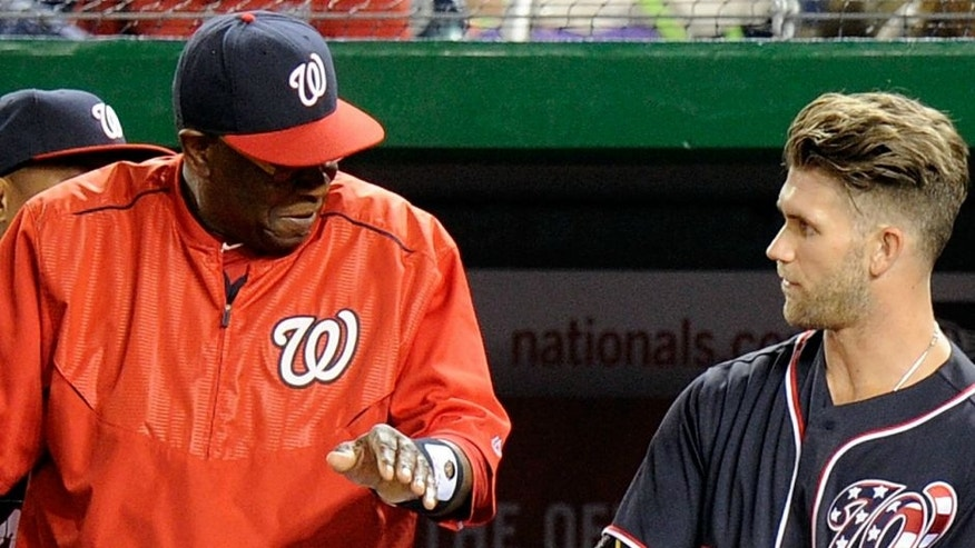 against the at Nationals Park on May 13, 2016 in Washington, DC.,WASHINGTON, DC - MAY 13: Manager Dusty Baker #12, assistant hitting coach Jacque Jones #24 and Bryce Harper #34 of the Washington Nationals watch the game against the Miami Marlins at Nationals Park on May 13, 2016 in Washington, DC. (Photo by G Fiume/Getty Images)