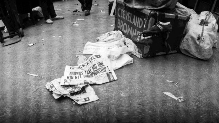 CLEVELAND, OH - DECEMBER 27, 1964: Newspapers with banner headlines on the floor of the lockerroom announce the Cleveland Browns as the champions of the National Football League after the NFL Championship Game on December 27, 1964 against the Baltimore Colts at Municipal Stadium in Cleveland, Ohio. Also pictured with the newspapers are towels, a pair of game-worn cleats, a Cleveland Browns' equipment trunk and equipment duffel bags. 1964 NFL Championship10-26 (Photo by: Diamond Images/Getty Images)