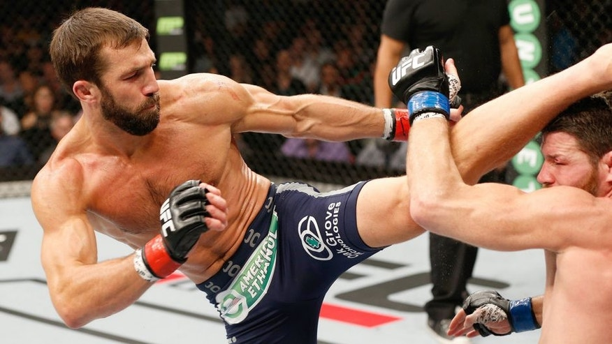 SYDNEY, AUSTRALIA - NOVEMBER 08: (L-R) Luke Rockhold of the United States kicks Michael Bisping of England in their middleweight bout during the UFC Fight Night event inside Allphones Arena on November 8, 2014 in Sydney, Australia. (Photo by Josh Hedges/Zuffa LLC/Zuffa LLC via Getty Images)