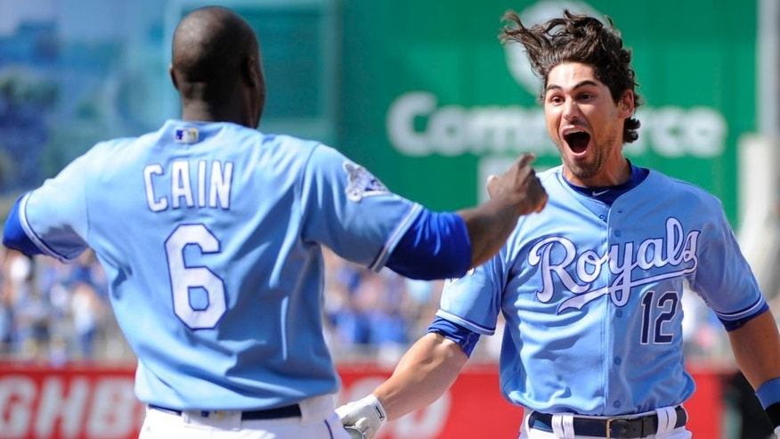 KANSAS CITY, MO - MAY 28: Brett Eibner #12 of the Kansas City Royals celebrates his game-winning RBI single with Lorenzo Cain #6 of the Kansas City Royals in the ninth inning against the Chicago White Sox at Kauffman Stadium on May 28, 2016 in Kansas City, Missouri. The Royals won 8-7. (Photo by Ed Zurga/Getty Images)