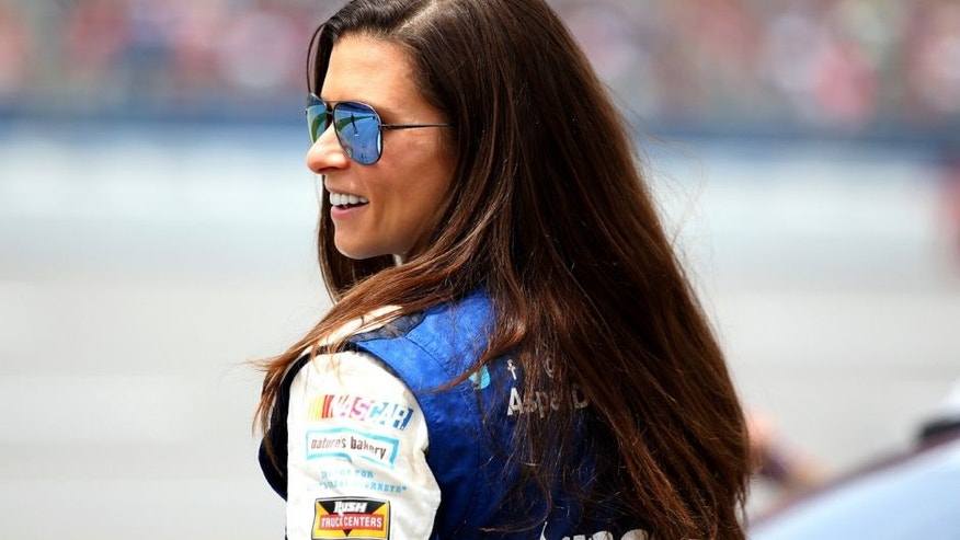 TALLADEGA, AL - APRIL 30: Danica Patrick, driver of the #10 Aspen Dental Chevrolet, stands on the grid during qualifying for the NASCAR Sprint Cup Series GEICO 500 at Talladega Superspeedway on April 30, 2016 in Talladega, Alabama. (Photo by Sean Gardner/Getty Images)