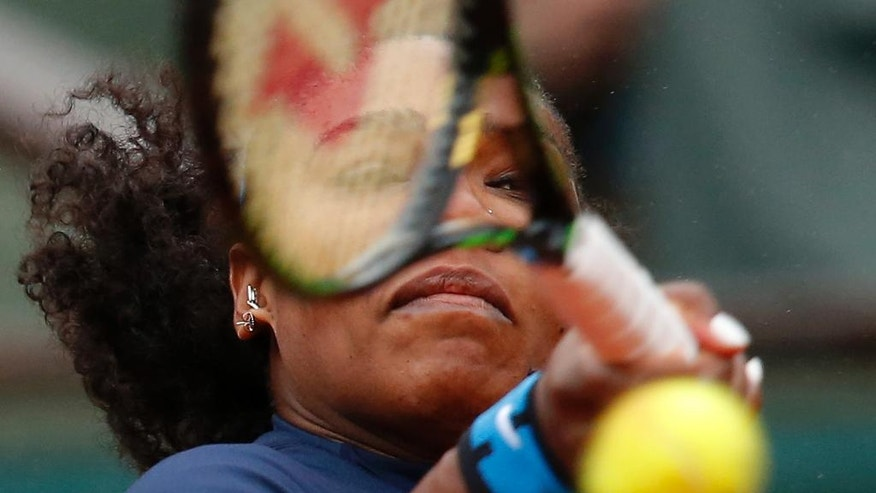 Serena Williams of the U.S. returns the ball in the quarterfinal match of the French Open tennis tournament against Kazakhstan's Yulia Putintseva at the Roland Garros stadium in Paris, France, Thursday, June 2, 2016. (AP Photo/Michel Euler)