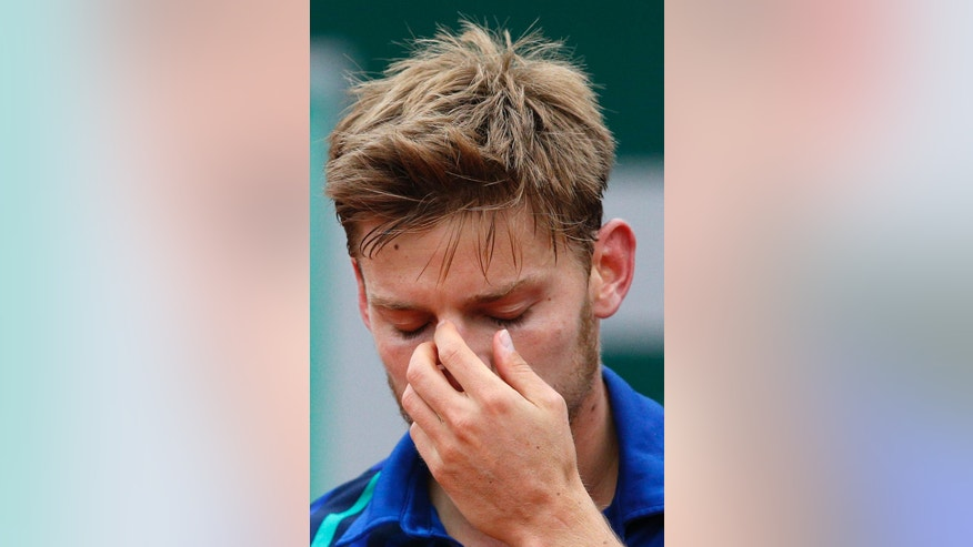 Belgium's David Goffin reacts as he plays Austria's Dominic Thiem during their quarterfinal match of the French Open tennis tournament at the Roland Garros stadium, Thursday, June 2, 2016 in Paris.  (AP Photo/Christophe Ena)