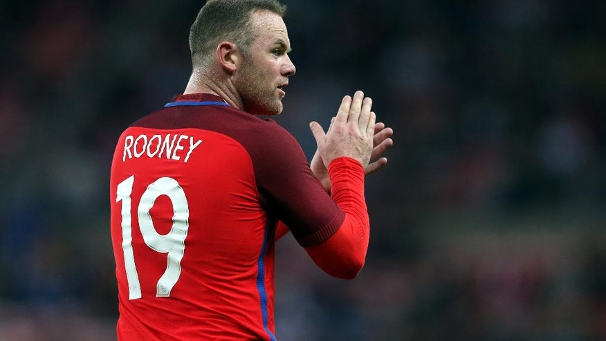FILE - In this Friday, May 27, 2016 file photo, England's captain Wayne Rooney applaudes to his teammates during the international friendly soccer match between England and Australia at the Stadium of Light, Sunderland, England. (AP Photo/Scott Heppell)