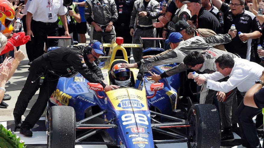 Alexander Rossi is congratulated after winning the 100th running of the Indianapolis 500 auto race as he pulls into victory lane at Indianapolis Motor Speedway in Indianapolis, Sunday, May 29, 2016. (AP Photo/Darron Cummings)