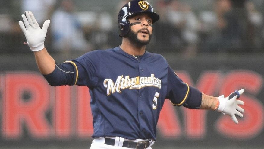 Milwaukee Brewers shortstop Jonathan Villar reacts after driving in a run with a double in the sixth inning against the Philadelphia Phillies.