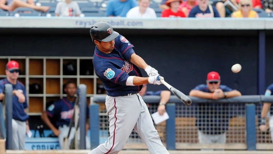 Minnesota Twins' Kurt Suzuki connects for a solo home run off a pitch fro Tampa Bay Rays relief pitcher Jhan Marinez in the seventh inning of a spring training baseball game, Friday, March 25, 2016, in Port Charlotte, Fla. (AP Photo/Tony Gutierrez)