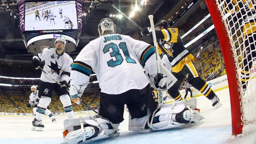 A puck shot by Pittsburgh Penguins' Conor Sheary rattles out of the net on the game-winning goal behind San Jose Sharks goalie Martin Jones during overtime in Game 2 of the NHL hockey Stanley Cup Finals on Wednesday, June 1, 2016, in Pittsburgh. The Penguins won 2-1 to take a 2-0 lead in the series. (Bruce Bennett/Pool Photo via AP)