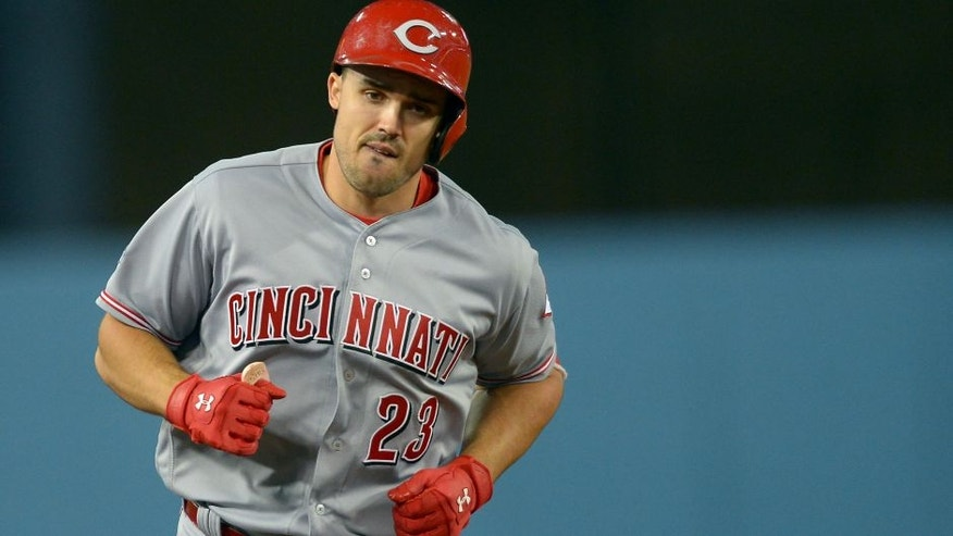 <p>Cincinnati Reds left fielder Adam Duvall rounds the bases after a home run against the Los Angeles Dodgers.</p>