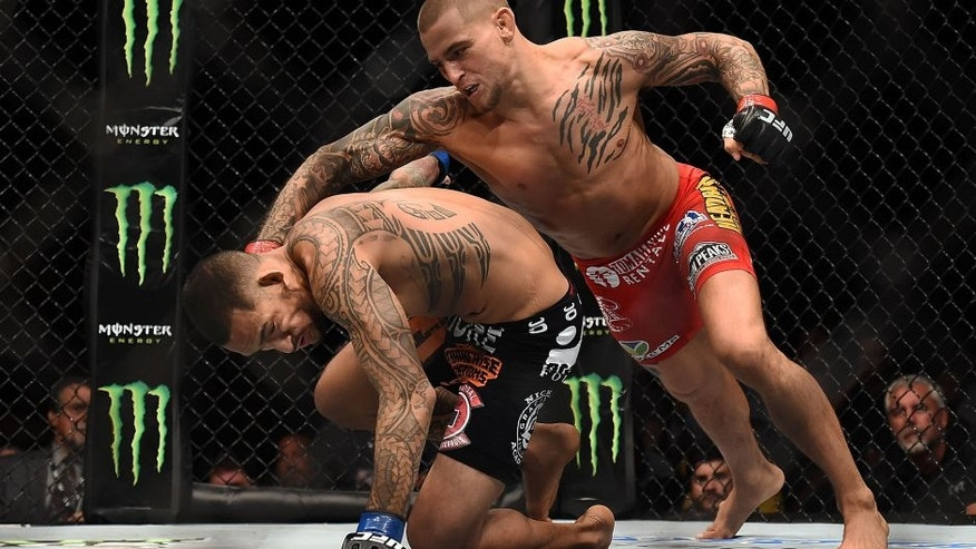 NEW ORLEANS, LA - JUNE 06: Dustin Poirier punches Yancy Medeiros in their lightweight bout during the UFC Fight Night event at Smoothie King Center on June 6, 2015 in New Orleans, Louisiana. (Photo by Stacy Revere/ Zuffa LLC/Zuffa LLC via Getty Images)