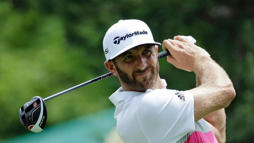 Dustin Johnson watches his tee shot on the 15th hole during the first round of the Memorial golf tournament, Thursday, June 2, 2016, in Dublin, Ohio. (AP Photo/Darron Cummings)