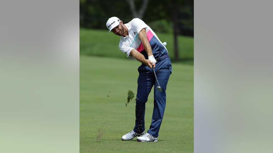 Dustin Johnson hits from the 14th fairway during the first round of the Memorial golf tournament, Thursday, June 2, 2016, in Dublin, Ohio. (AP Photo/Darron Cummings)