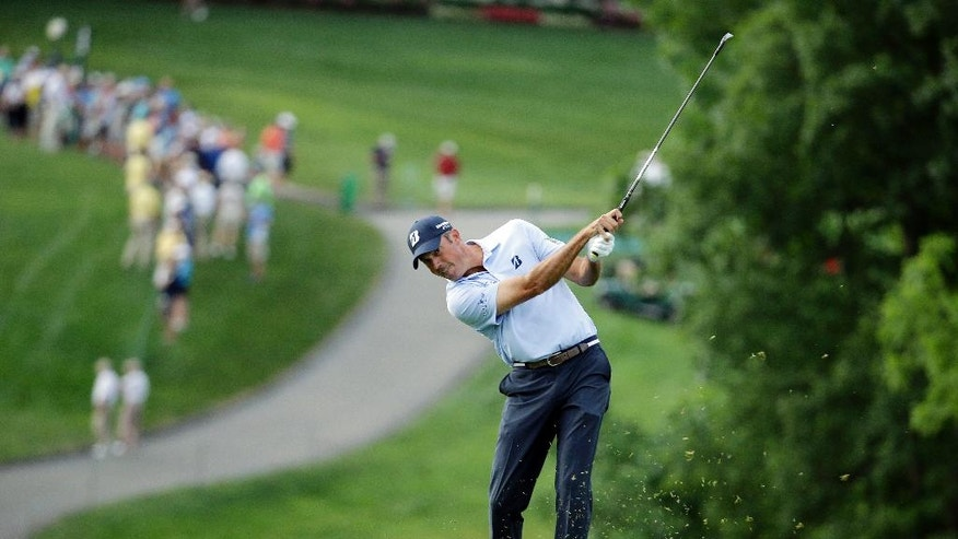 Matt Kuchar hits on the 10th hole during the second round of the Memorial golf tournament, Friday, June 3, 2016, in Dublin, Ohio. (AP Photo/Darron Cummings)